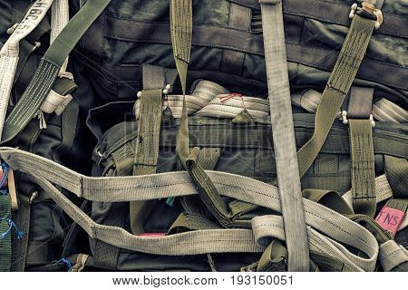 Green paratrooper parachute bags pilled up background