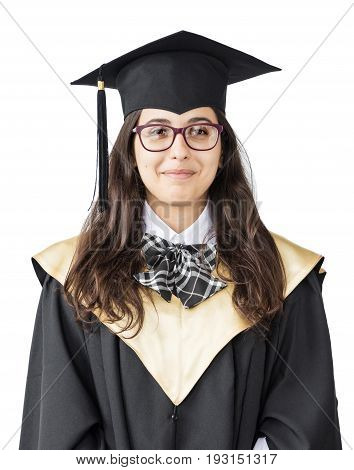 Young girl graduate of the University with glasses academic cap and black gown standing isolated on white background