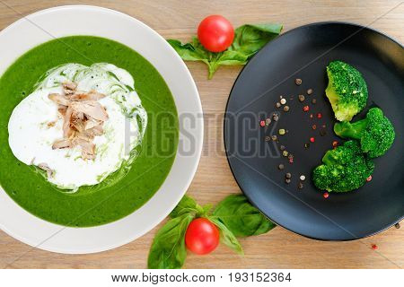 a plate of tasty hot soup with broccoli