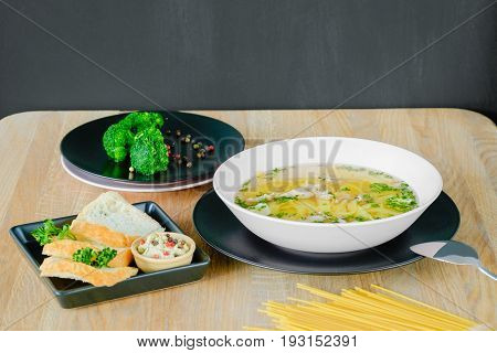 hot lunch with noodles on a plate with bread