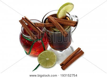 Glass cup with mulled wine on white background