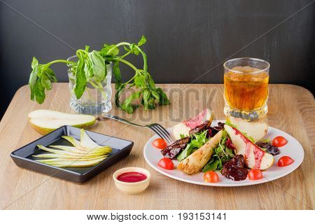 salad with pear sauce served in a restaurant way