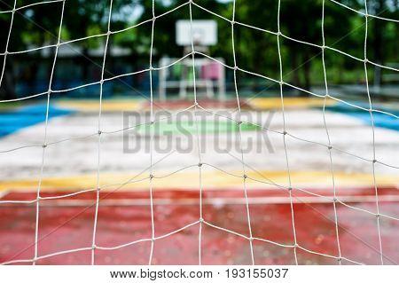 Goal football and White soccer net rain in stadium outdoor