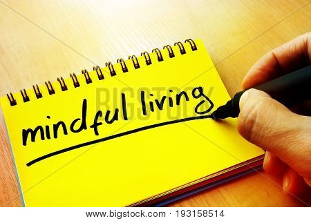 Mindful living written in a note by hand.