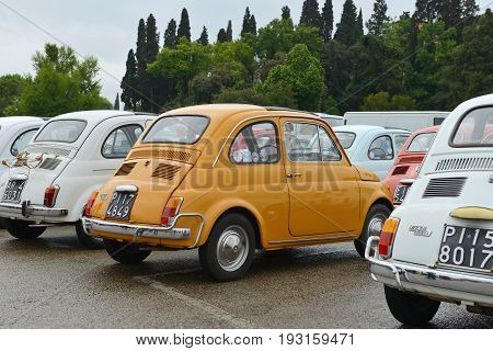 FLORENCE ITALY - APRIL 28: Italian cars Fiat 500 Parked on April 28 2013 in Florence. Fiat 500 - small city car manufactured and marketed by Fiat Automobiles from 1957 to 1975.
