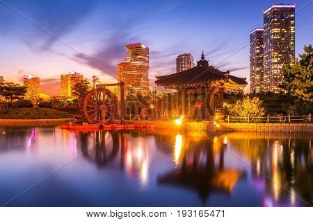 Traditional And Modern Architecture Of Seoul City After Sunset, Central Park In Songdo International
