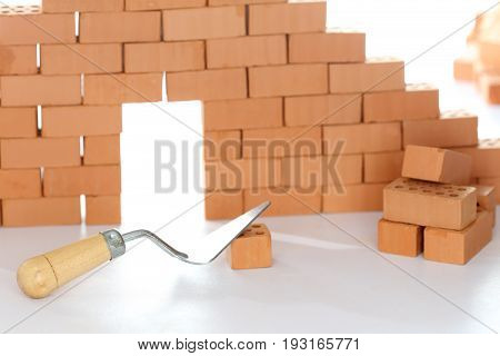 building a house with bricks and tool