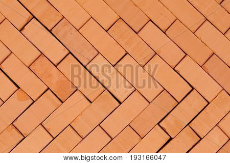 herring -bone pattern on a basement with red bricks