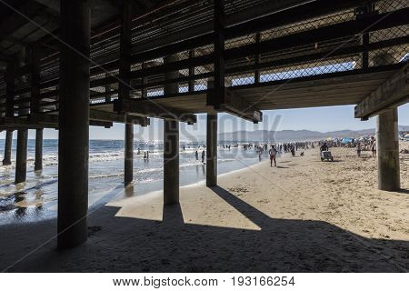 Santa Monica, California, USA - June 26, 2017:  Big summer crowds at Santa Monica beach in Southern California.