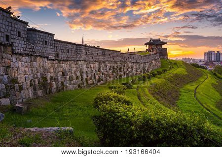 Hwaseong Fortress In Sunset, Traditional Architecture Of Korea At Suwon, South Korea.