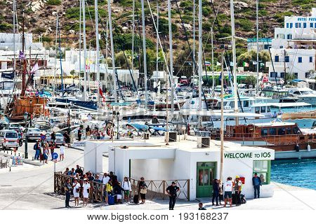 IOS, GREECE-OCTOBER 01, 2015: colorful activity at the ferry port of the popular Greek Ios Island, Cyclades