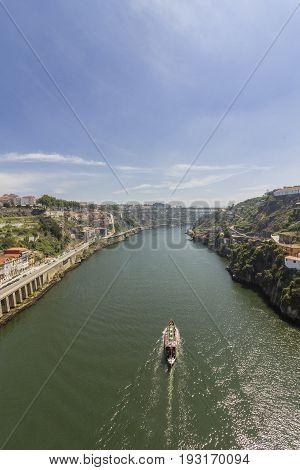Porto landscape view over Douro River and turistic boat on a summer day Portugal.