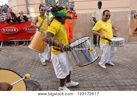 LE MANS, FRANCE - JUNE 13, 2014: Brazilian man dancing at a parade of pilots racing in Le mans, France.