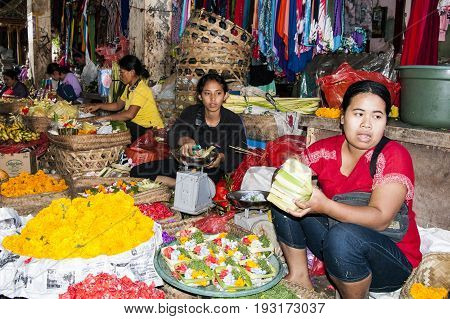 Ubud Bali Indonesia - August 01 2013. Food fruits fishs and spices sale on the typical market by woman