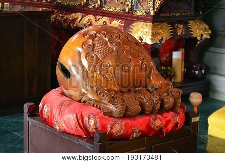 Wooden Fish Wakeful Drum s muyu in Chinese Buddhist temple in Lumbini, Nepal - birthplace of Buddha Siddhartha Gautama.