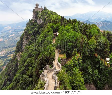 Castle of San Marino on the rock with footpath
