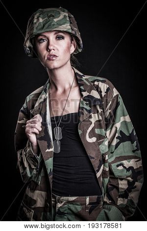 Beautiful female soldier wearing camouflage