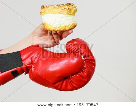 Person Wearing Boxing Gloves Holding Cream Cake