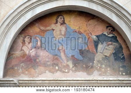 ROME, ITALY - SEPTEMBER 01: Fresco of Saint Dominic with Christ, tympani over the side entrance of Basilica Santa Maria Sopra Minerva, Rome, Italy on September 01, 2016.
