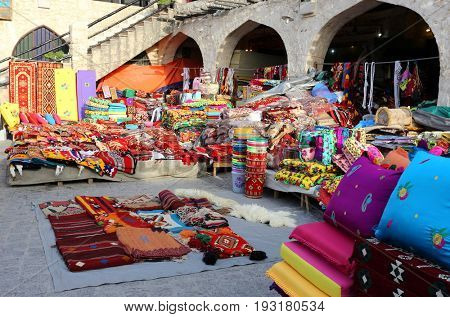 Colourful textiles on show at one of the shops in Souq Waqif market, Doha, Qatar