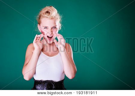 Angry Young Girl Screaming, Hands Close To Mouth