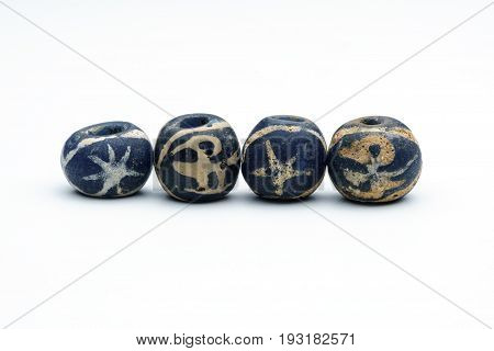Ancient blue bird glass beads on white background