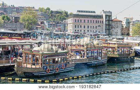 Istanbul Turkey - April 25 2017: Traditional fast food bobbing boats serving fish sandwiches at Eminonu