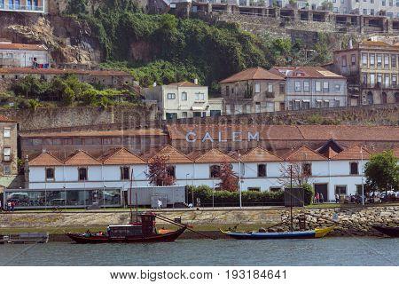 PORTO, PORTUGAL - APRIL 17, 2017: Boats at the Ribeira in the Douro River bank near the Dom Luis I Bridge, Porto, Portugal.