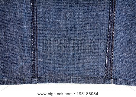 Piece of blue jeans fabric isolated on white background. Wrong side of fabric