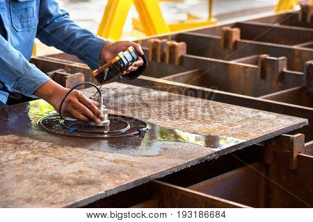 Ultrasonic test to detect imperfection or defect of steel plate in factory NDT Inspection.
