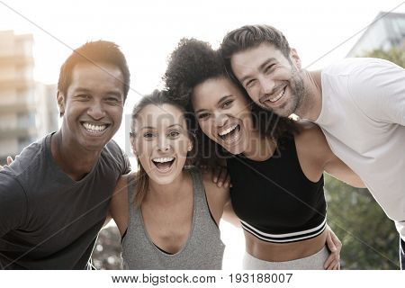 Group of atheltic people having fun together on running session