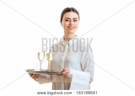 Cheerful young waitress smiling with trey in hands isolated on white background