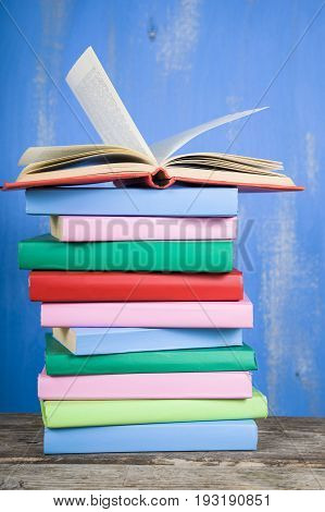 Stack Of Books On A Blue Background.