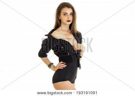 Charming young girl take off a jacket without bra under it and looking at the camera isolated on white background