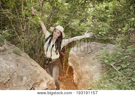 Pretty Asian woman hiking and climbing on trekking of mountains adventure, traveling and happiness.