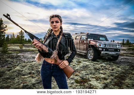 Young Woman With A Rifle Gun