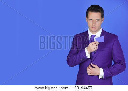 Businessman Holding Business Or Bank Card In Fashionable Suit
