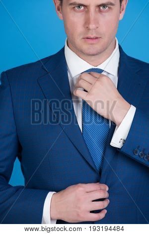 Boss Adjusting Tie In Elegant Navy Formal Suit
