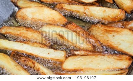 French fries is scorch cooking in stainless steel very hot pan Photo zoom in.
