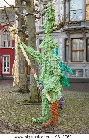 MAASTRICHT NETHERLANDS - JANUARY 16 2016: Vrijthof square. People and animals in stone and bronze by Han van Wetering. Sculpture dedicated to the carnival.