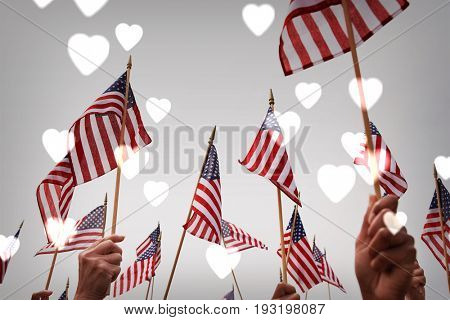 People Waving American Flags with hearts background