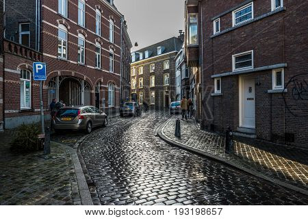 MAASTRICHT NETHERLANDS - JANUARY 16 2016: Old streets in the historic center. Stylization. Toning. Maastricht is the oldest city of the Netherlands and the capital city of the province of Limburg.