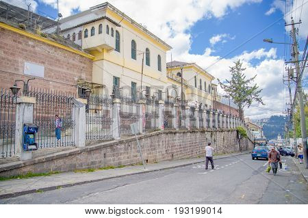 QUITO, ECUADOR - NOVEMBER 23, 2016: Unidentified people walking at outside, in the old prison Penal Garcia Moreno in the city of Quito.
