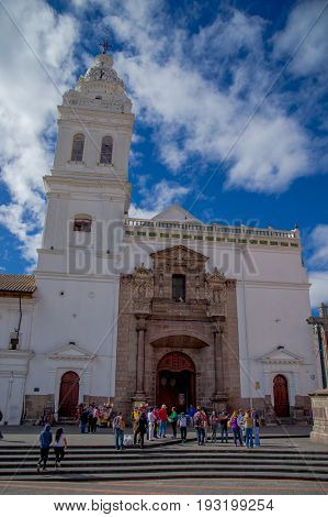 QUITO, ECUADOR - NOVEMBER 23, 2016: Unidentified people walking in historic Plaza de Santo Domingo in old town Quito Ecuador South America.