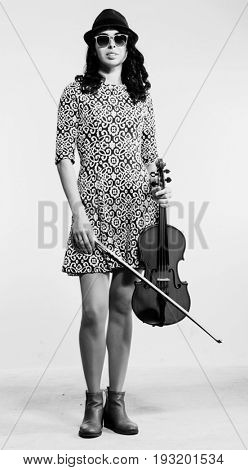 Young beautiful musician posing in studio on white background with viola in hand