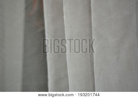 Draped wave white organza transparent of bridal veil texture for background