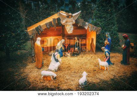 Nativity scene. Christmas. Christmas Manger scene with figurines newborn Jesus, Mary, Joseph, sheep and magi