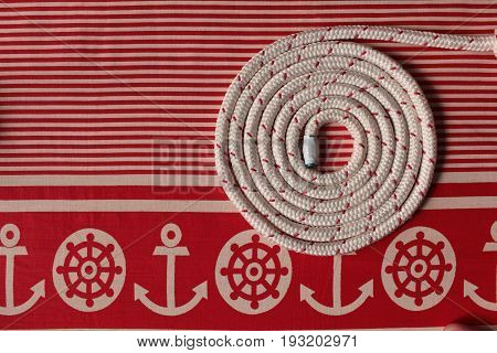 Rope round spiral red striped flat lay Marine background