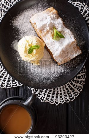 Austrian Apple Strudel With Vanilla Ice Cream And Coffee With Milk Close-up On The Table. Vertical T