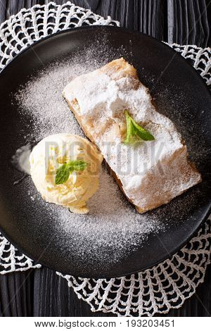 Homemade Apple Strudel With Vanilla Ice Cream And Mint Closeup On The Table. Vertical Top View